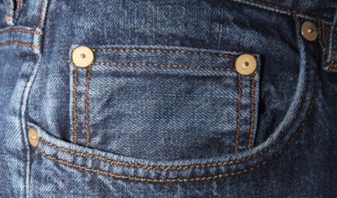 Here's What Those Little Buttons On Your Jean Pockets Are Actually For