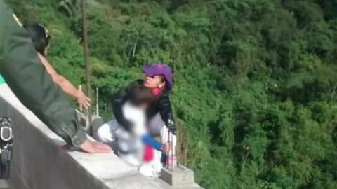 Desperately Tragic Scenes As Woman Jumps From Bridge With Her Son In Her Arms