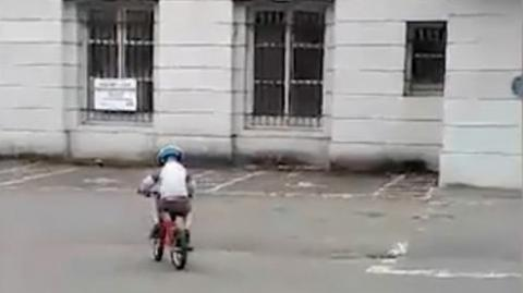 She Filmed Her Son Riding His Bike Then Something In The Footage Made Her Blood Run Cold
