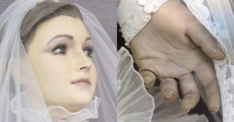 This 'Doll' Has Stood In A Shop Window For 85 Years - Her Hand Reveals What She Really Is...