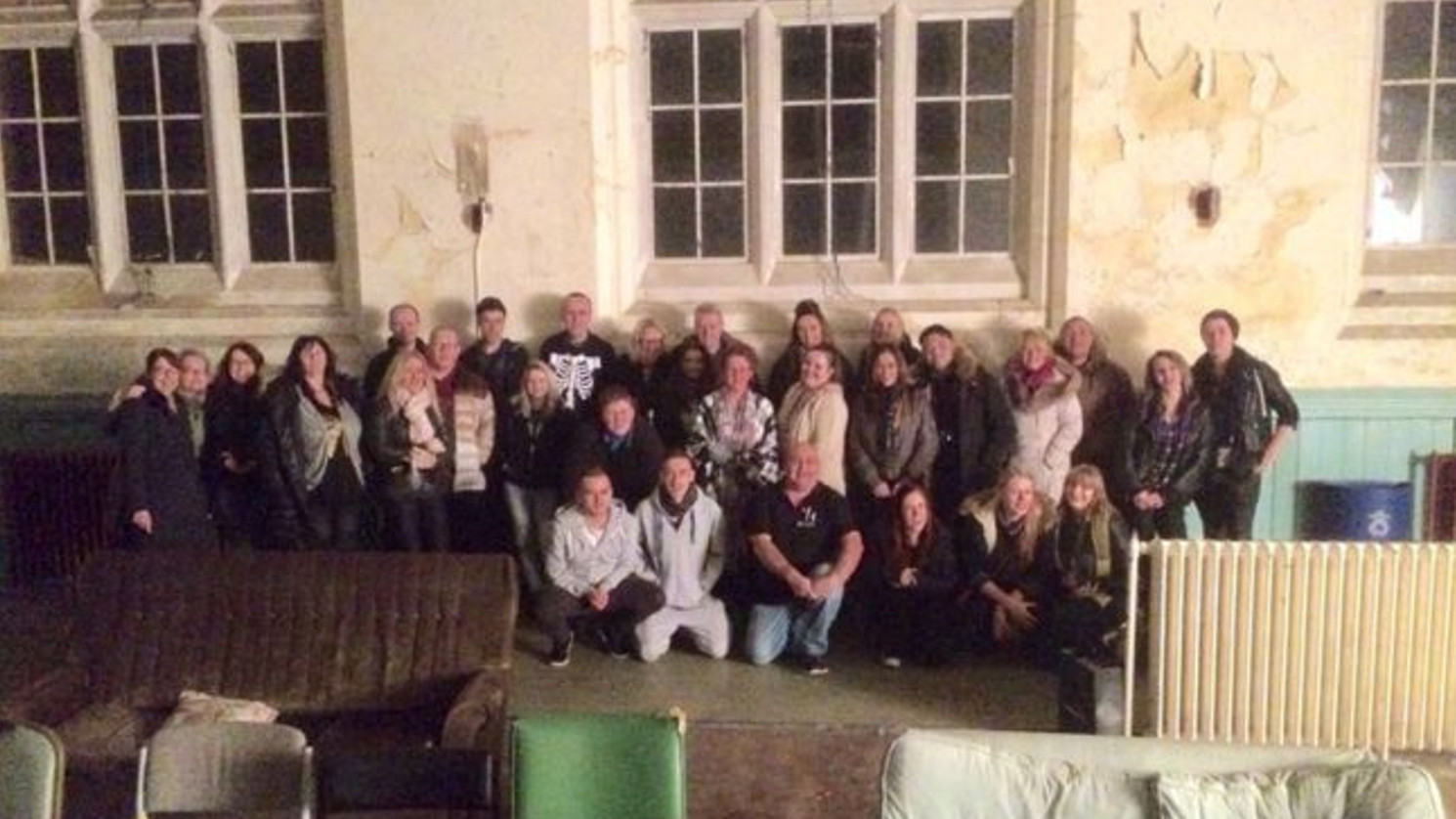 They Took This Group Photo At An Abandoned Asylum... But One Detail Made Their Blood Run Cold