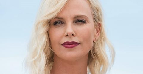 Charlize Theron Completely Changed With A Bold Look With Her Platinum Pixie Cut And Fishnet Dress