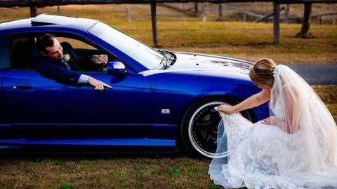 Bride slammed for cleaning husband's car with her wedding dress in 'humiliating ' photo